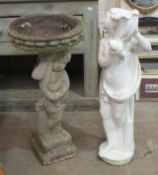 A cast concrete cherub bird bath, 82cm high and a cast concrete figure 'female water carrier',
