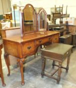 A walnut dressing table fitted with three drawers, 123cm wide, 76cm high, a triptych mirror and an