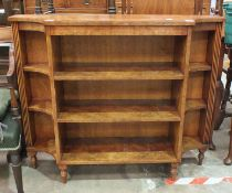 A reproduction burr elm open dwarf bookcase with concave corners, 109cm wide, 90cm high.