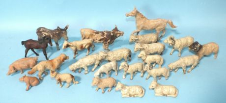 A quantity of composition farmyard animals: sheep (x14), cow and calf, horse and foal, donkey, pig