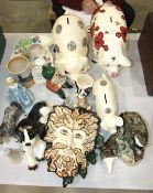 A collection of Babbacombe pottery, including three pig money banks, a Royal Worcester figure '