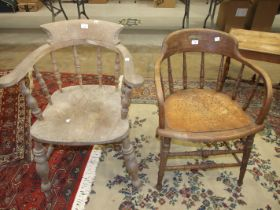An elm and beech captain's chair, old woodworm to one arm and an elm and oak office chair, (2).