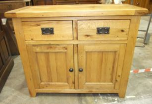 A modern oak cupboard, the rectangular top above two drawers and two cupboard doors, 99cm wide, 80cm