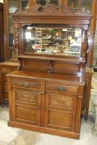 An Edwardian walnut sideboard, the mirrored back above two drawers and two cupboard doors, 120cm