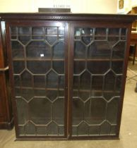 A Georgian mahogany astragal-glazed bookcase top with dentil cornice, 120cm wide, 130cm high and a