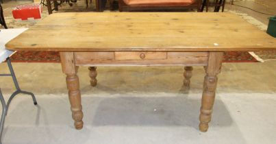 A pine kitchen table fitted with a single drawer, on turned legs, 180 x 94cm.