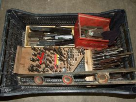 A collection of lathe tools and milling machine bits.