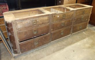 An early-20th century bank of nine hardwood drawers, each with recessed handles and vacant name