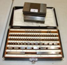 A surface plate marked PPSC, 90 x 70 x 125cm and a gauge block set by Pitter Gauge and Tool Co. Ltd.