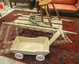 A pine pig truckle, 170 x 57cm, a washing dolly, a stool and a trolley, (4).