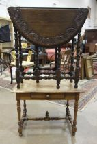A faded mahogany rectangular-top low table fitted with a single drawer, on turned legs and