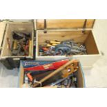 A large collection of woodworking and hand tools, including chisels, spanners, hammers, saws, etc,