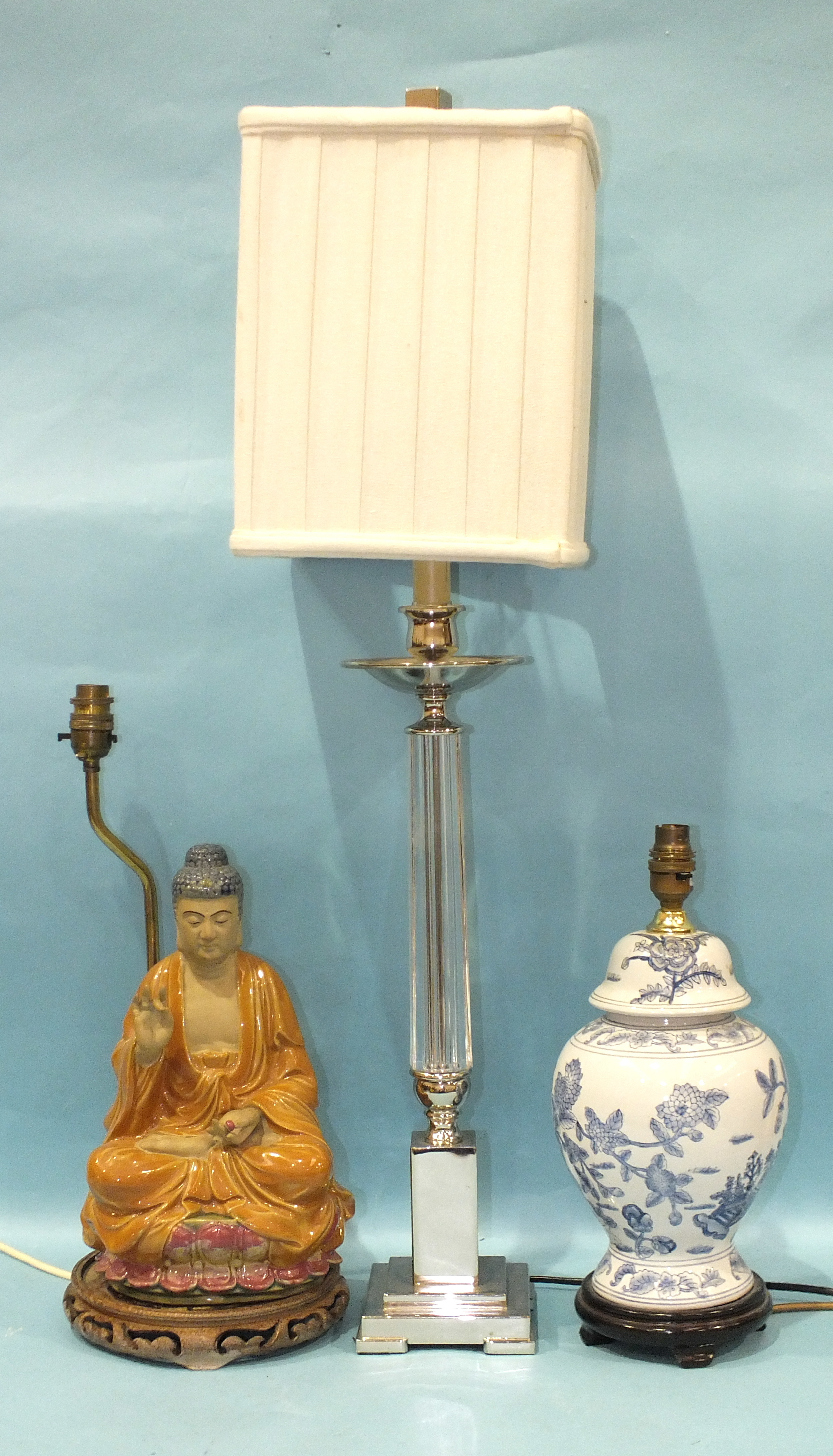 A modern chrome-plated and plastic column table lamp, another ceramic lamp in the form of a seated