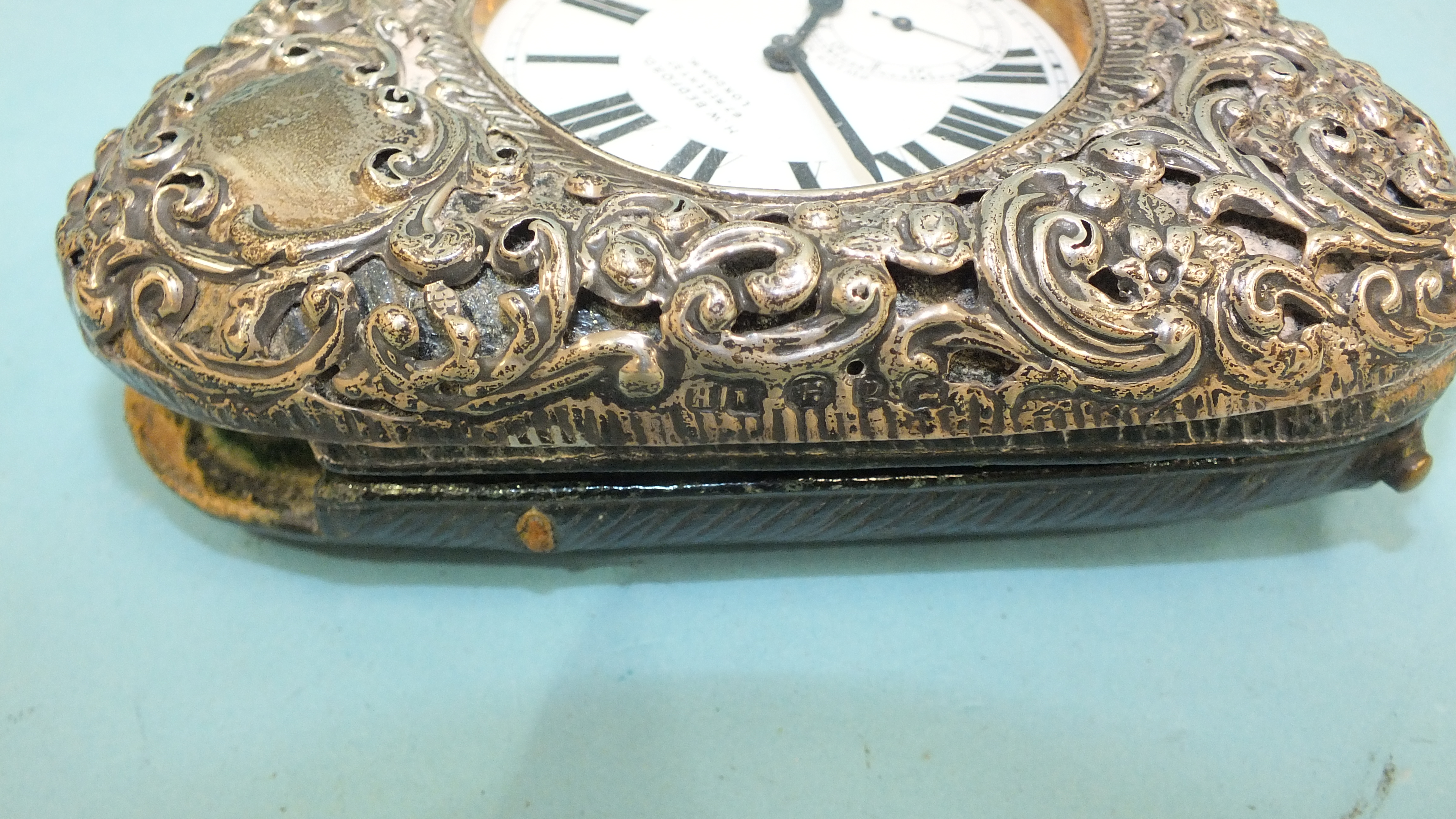 A silver embossed pocket watch holder of triangular form, Birmingham 1898, 11.5 x 11.5cm, (holes - Image 2 of 15