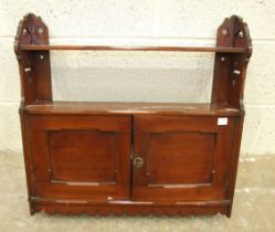 An Edwardian mahogany small two-door wall cupboard fitted with a shelf, 61cm wide, 57cm high.