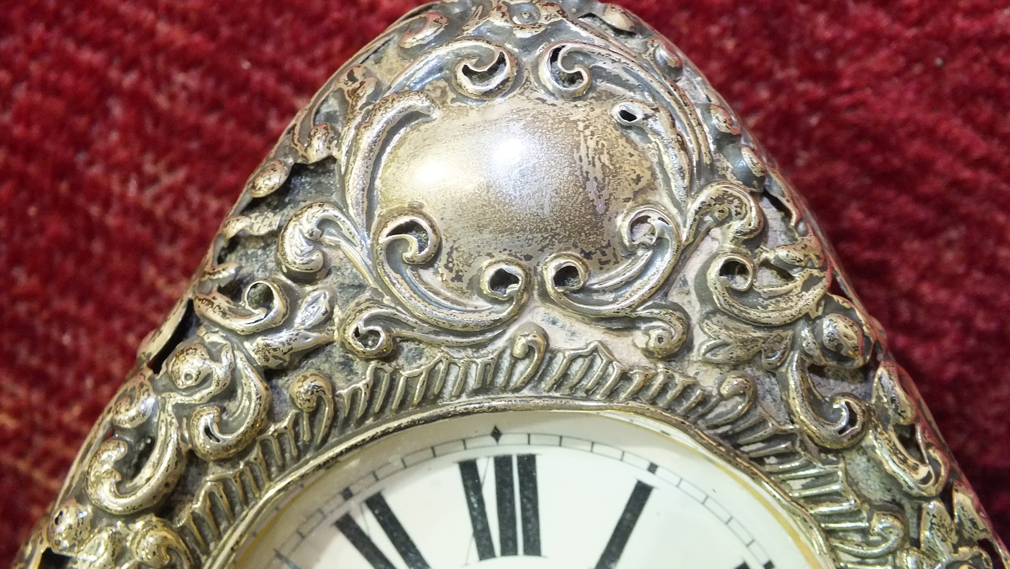 A silver embossed pocket watch holder of triangular form, Birmingham 1898, 11.5 x 11.5cm, (holes - Image 7 of 15