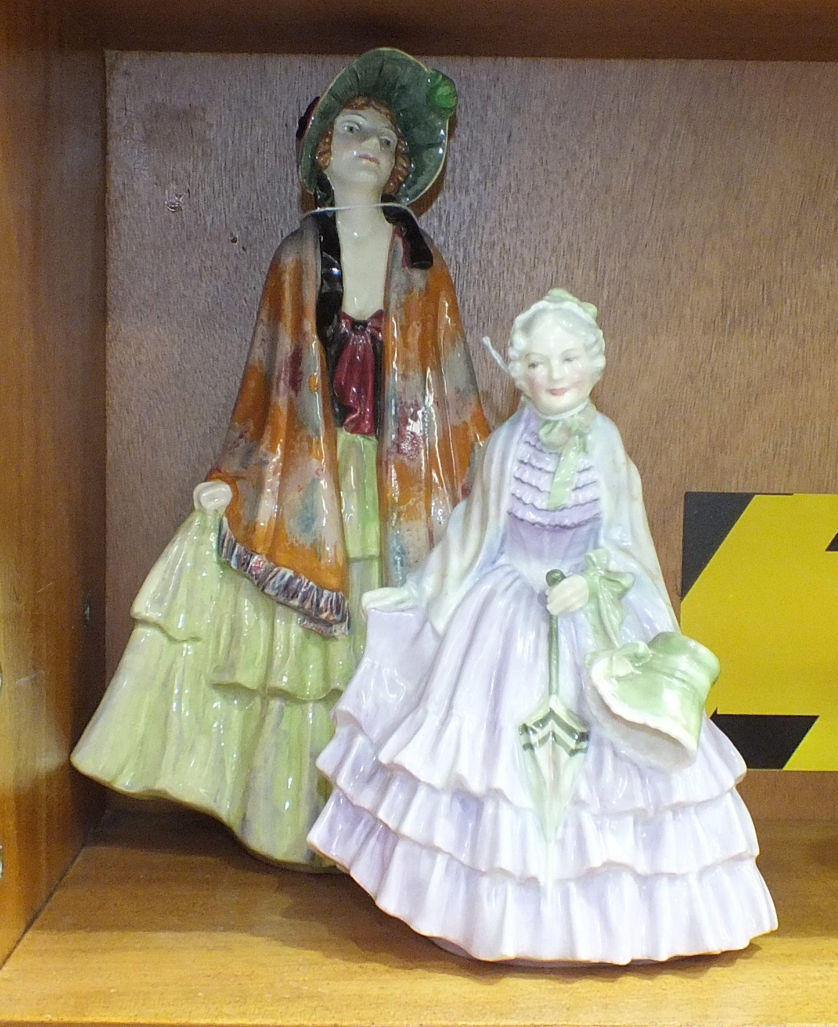 A Royal Doulton figurine 'Rhoda' HN1573, 26.5cm high and another 'Gentlewoman' HN1632, 19cm high, (