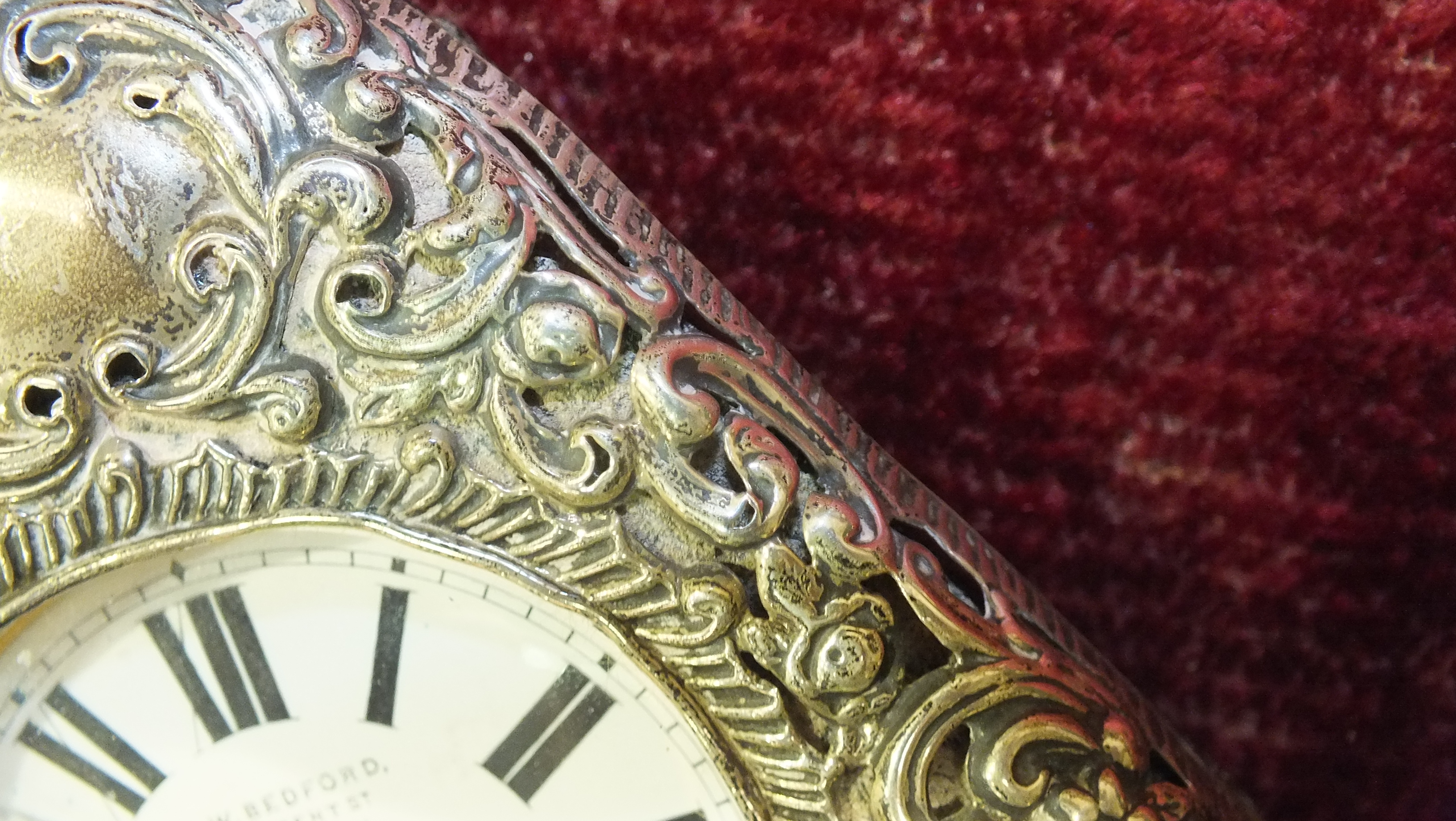 A silver embossed pocket watch holder of triangular form, Birmingham 1898, 11.5 x 11.5cm, (holes - Image 8 of 15
