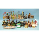 A collection of whisky and other spirit miniatures, approximately 40.