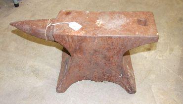 An iron anvil, 56cm long, 29cm high.