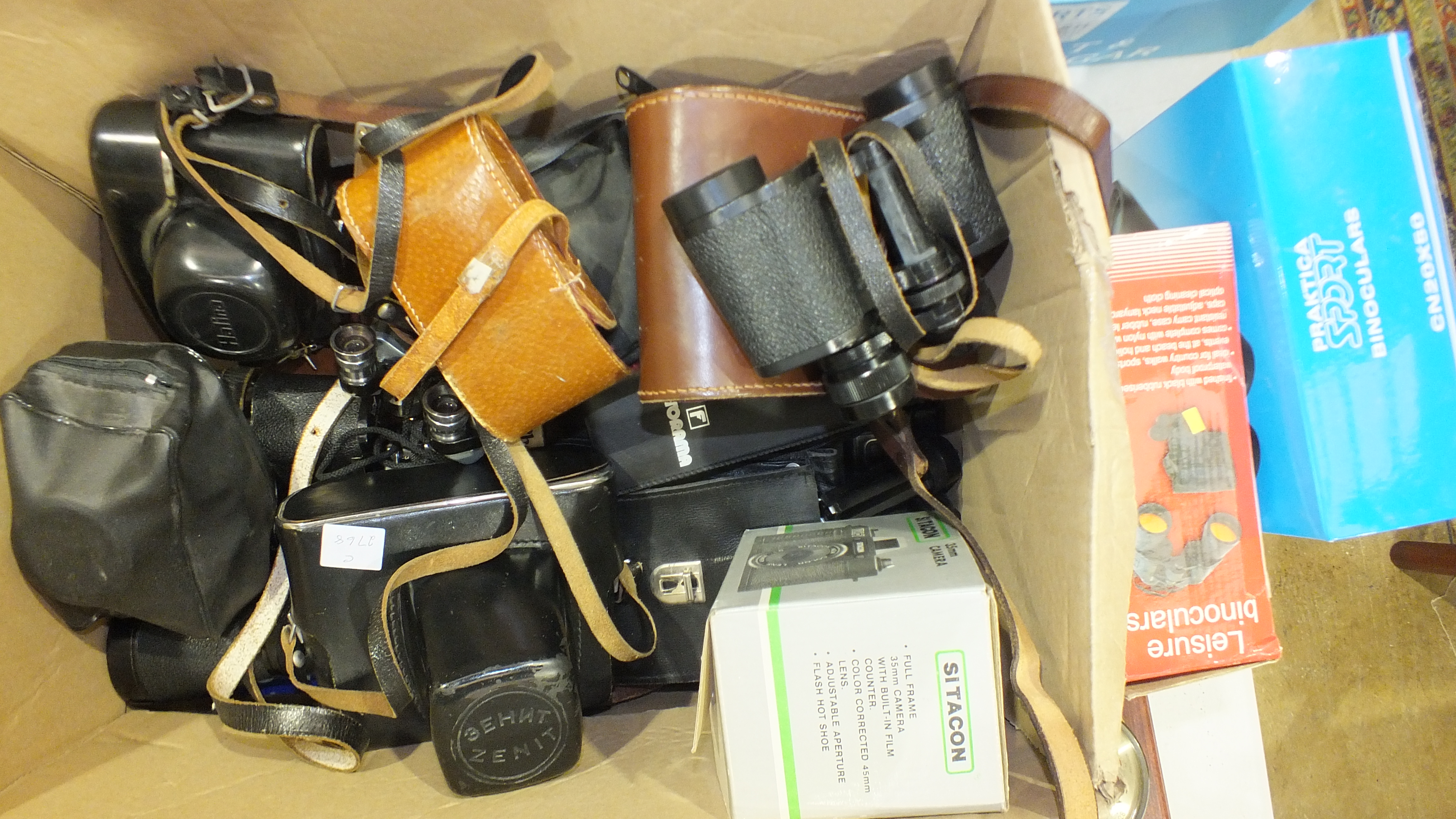 A Zenit-E 35mm camera in case, a Halina camera, other cameras, a pair of Milo 7 x 18 field glasses - Image 3 of 3
