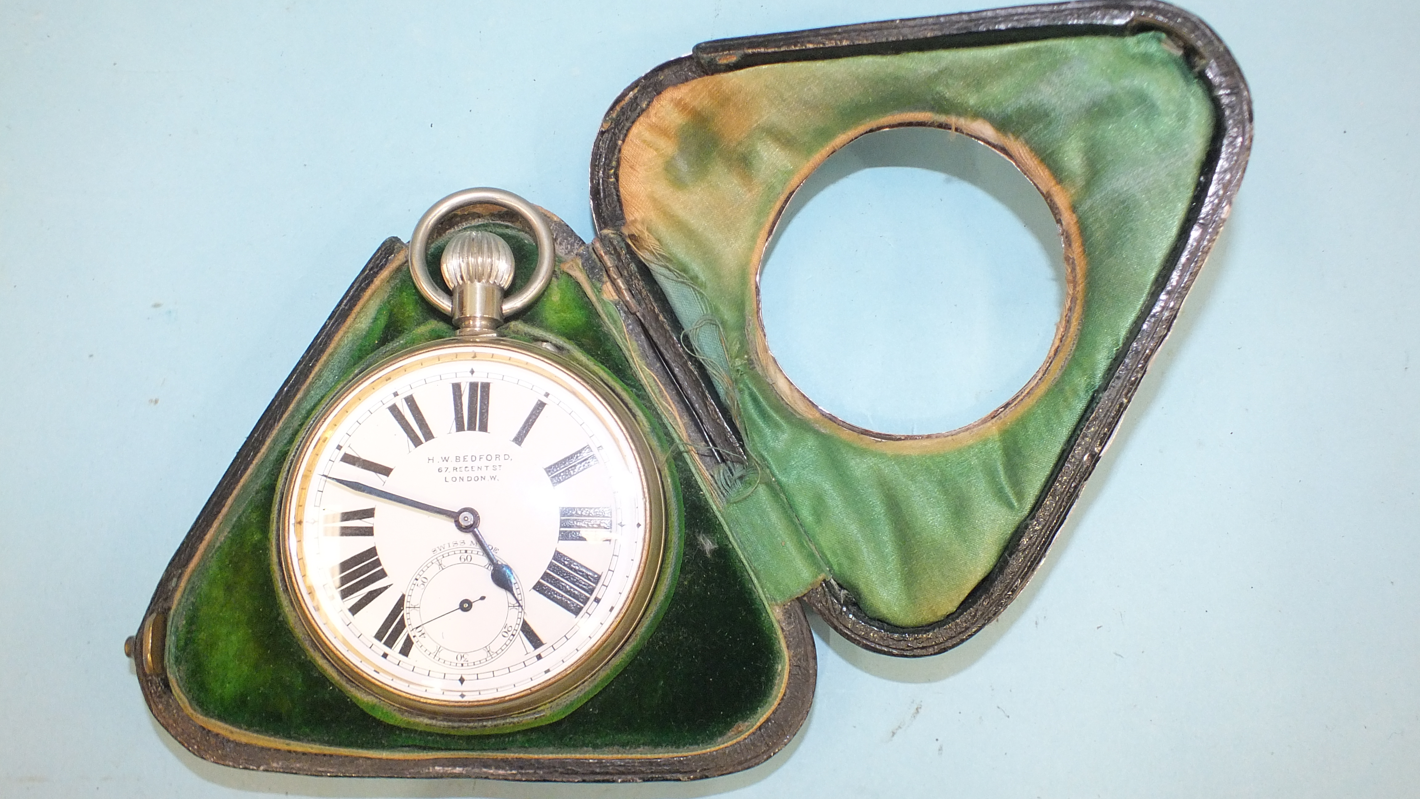 A silver embossed pocket watch holder of triangular form, Birmingham 1898, 11.5 x 11.5cm, (holes - Image 3 of 15