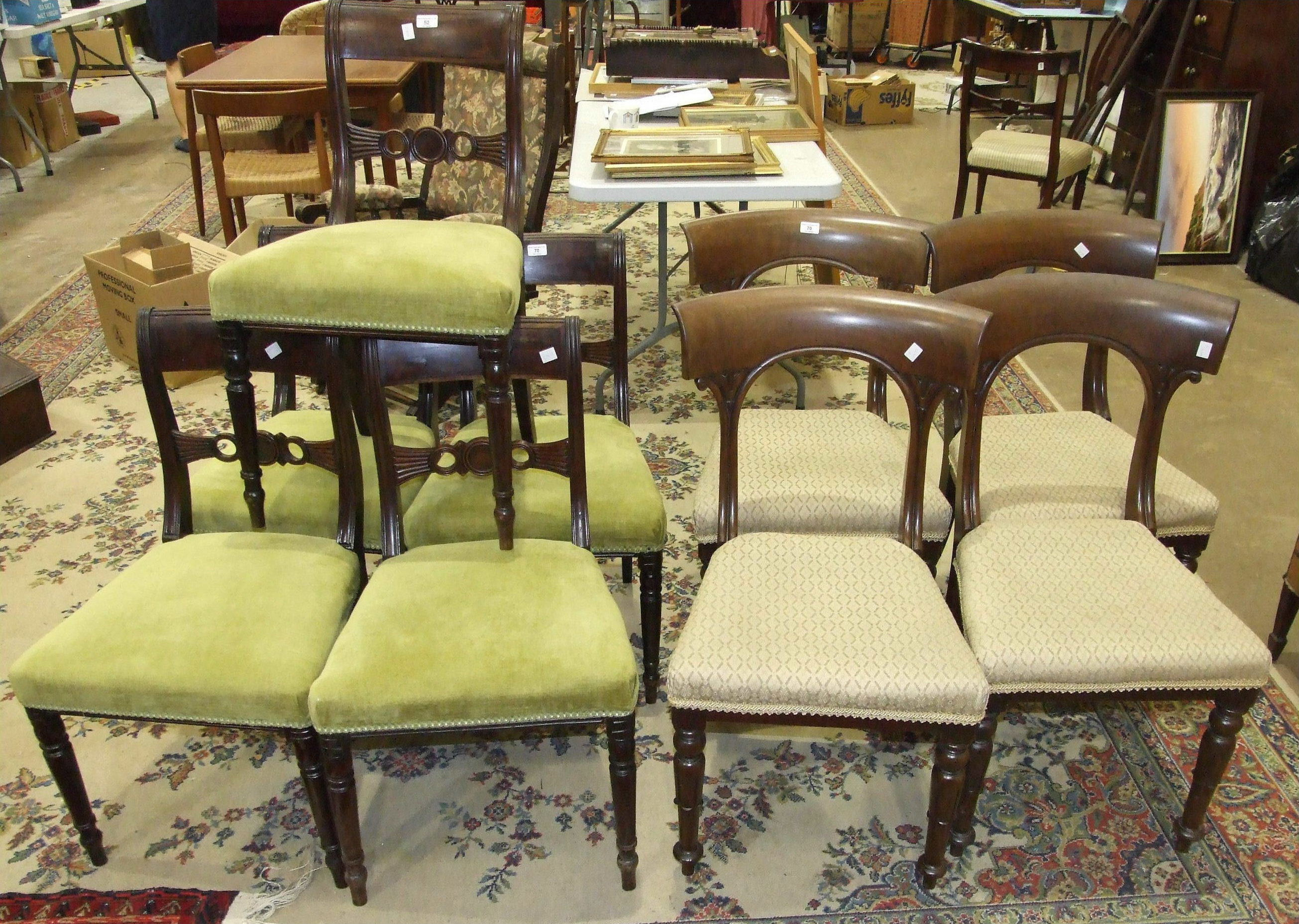 A set of four early-Victorian mahogany dining chairs, with curved top rails and open backs, also