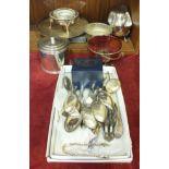 A plated circular tea caddy with cover, 12.5cm high, 11.5cm diameter, a silver napkin ring, (a/f),