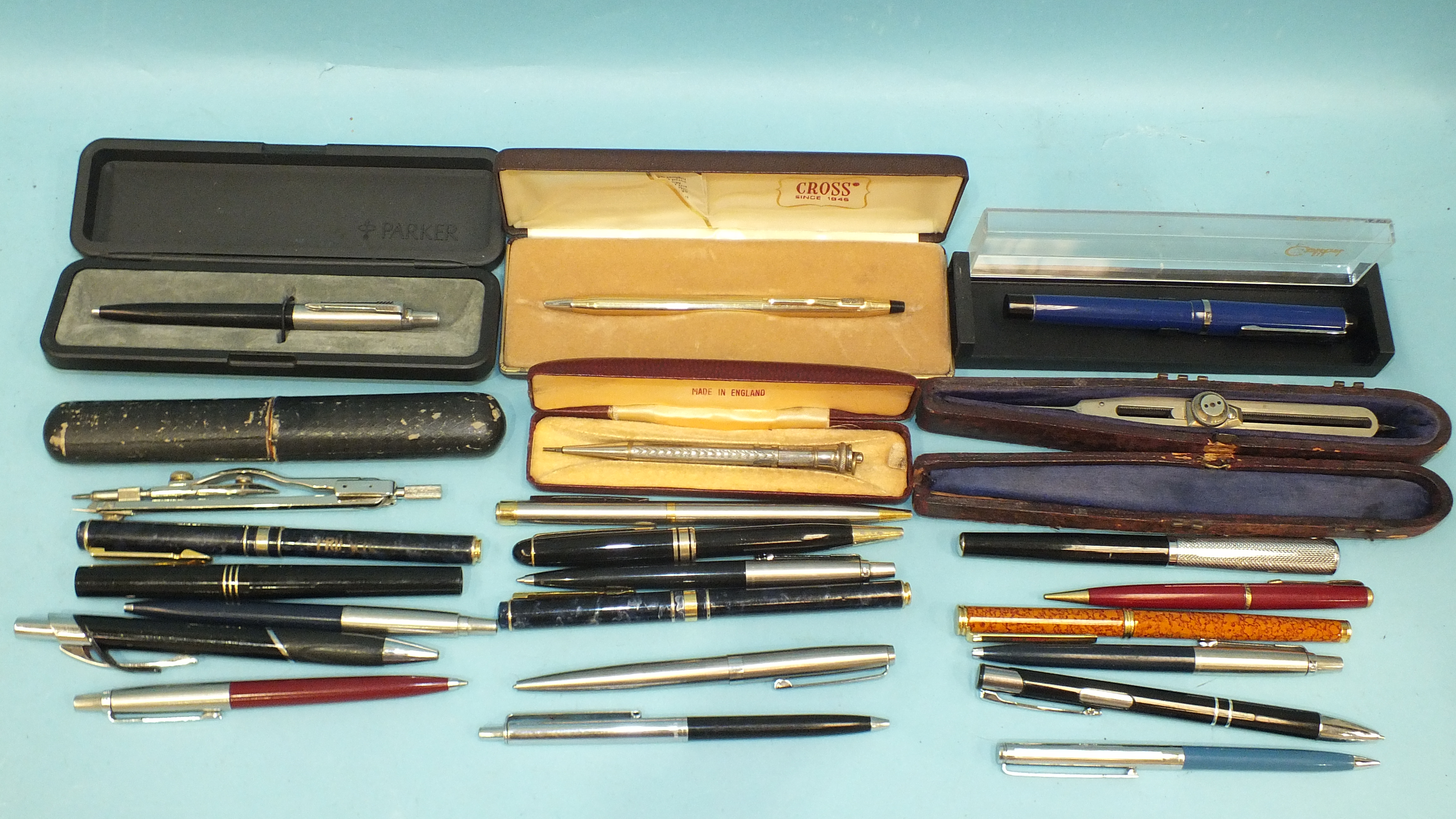 A collection of four modern fountain pens, propelling pencils, ballpoint pens and miscellaneous
