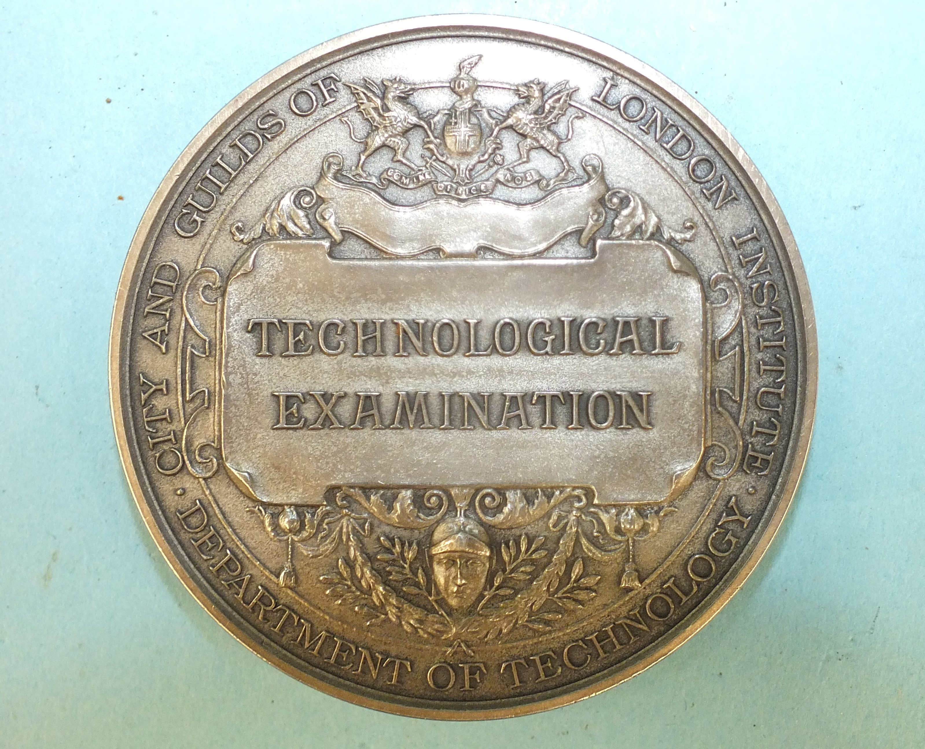 A WWI bronze death plaque awarded to Charles Simmons, a 1951 Technological Examination medallion and - Image 3 of 3