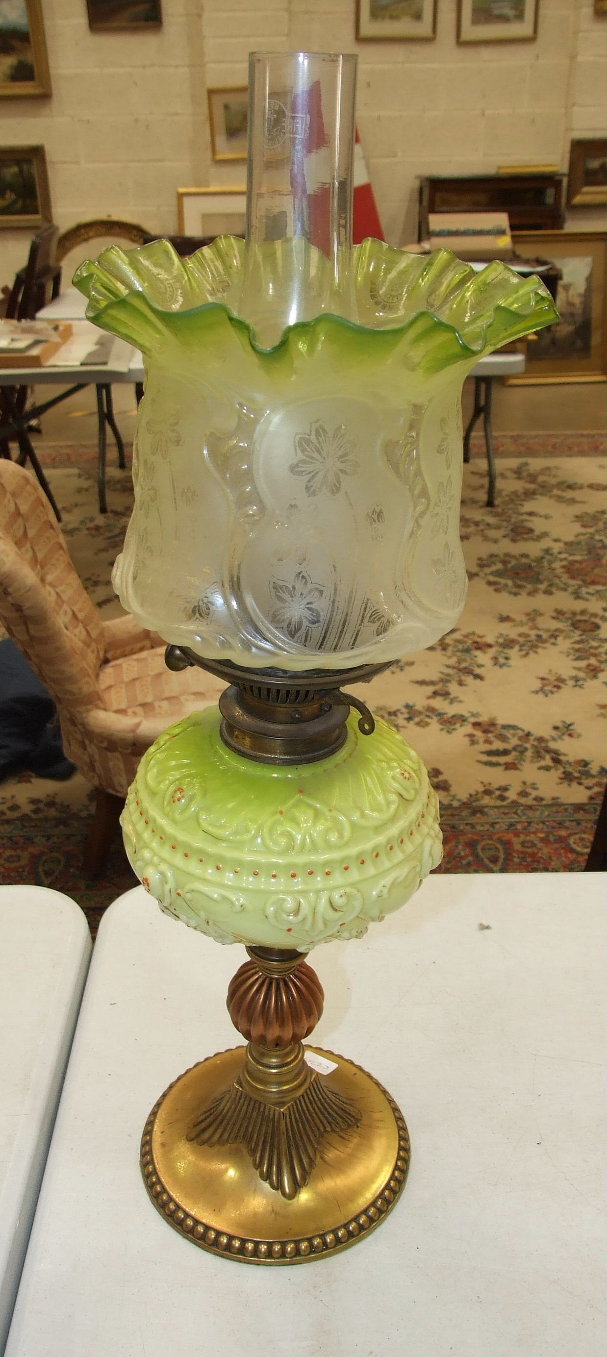A Victorian brass and copper oil lamp with moulded pale green glass reservoir and etched glass - Image 2 of 14