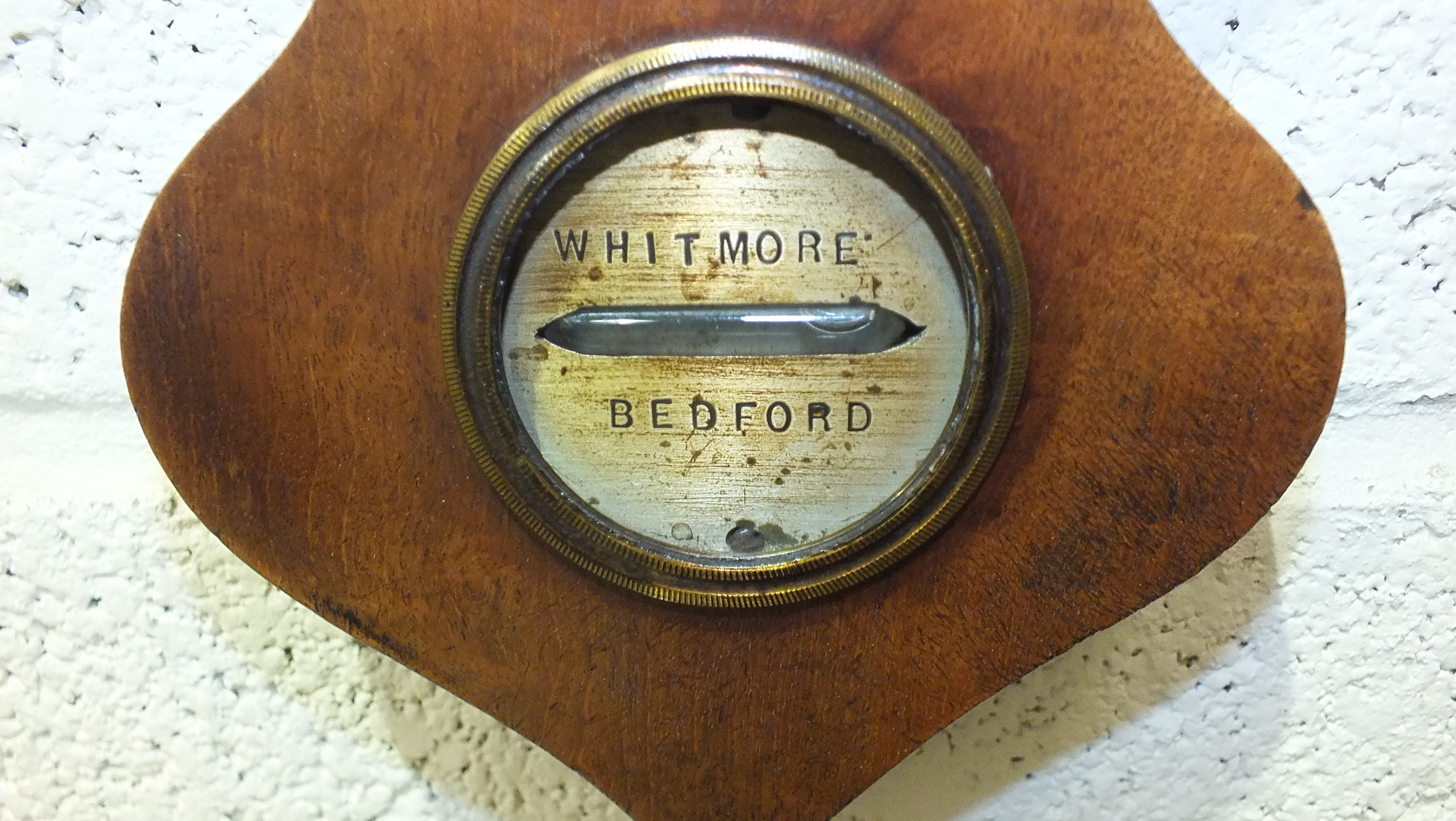 A mahogany wheel barometer with silvered dry/damp thermometer and barometer dials, the spirit - Image 3 of 4