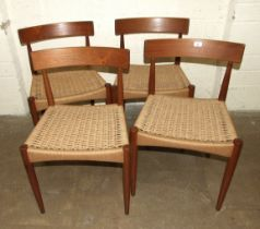 A set of four 1960's Danish Mogens Kold teak dining chairs with woven seats, each labelled, together