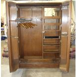 """An oak """"Compactum"""" wardrobe with fully-fitted interior, including glazed compartments, trouser and"""