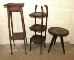 A carved wood three-legged table, a three-tier cake stand and a plant stand, (3).
