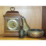 An Elliott walnut-cased timepiece, 24cm high, (a/f), a brass powder flask with embossed