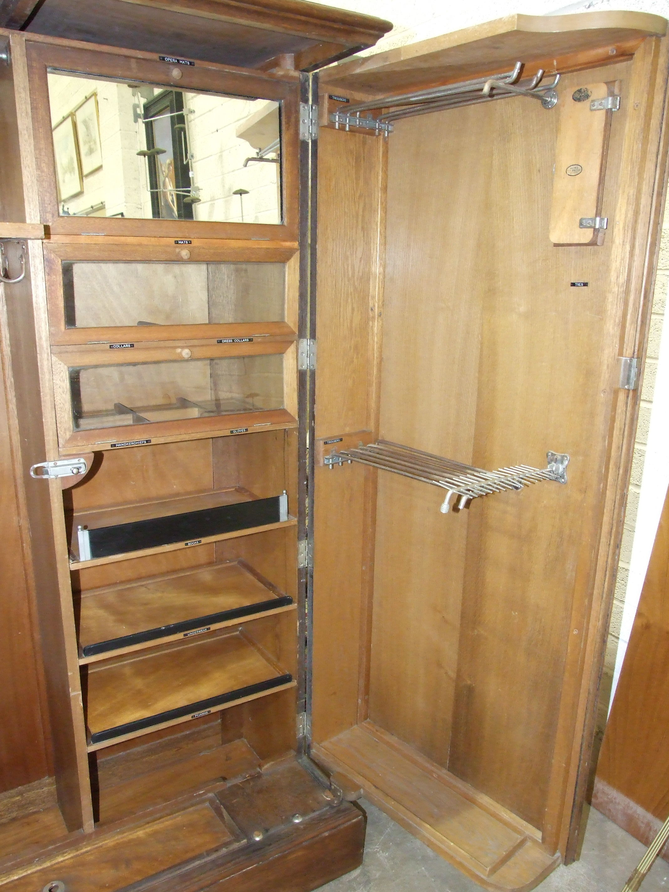 """An oak """"Compactum"""" wardrobe with fully-fitted interior, including glazed compartments, trouser and - Image 3 of 5"""