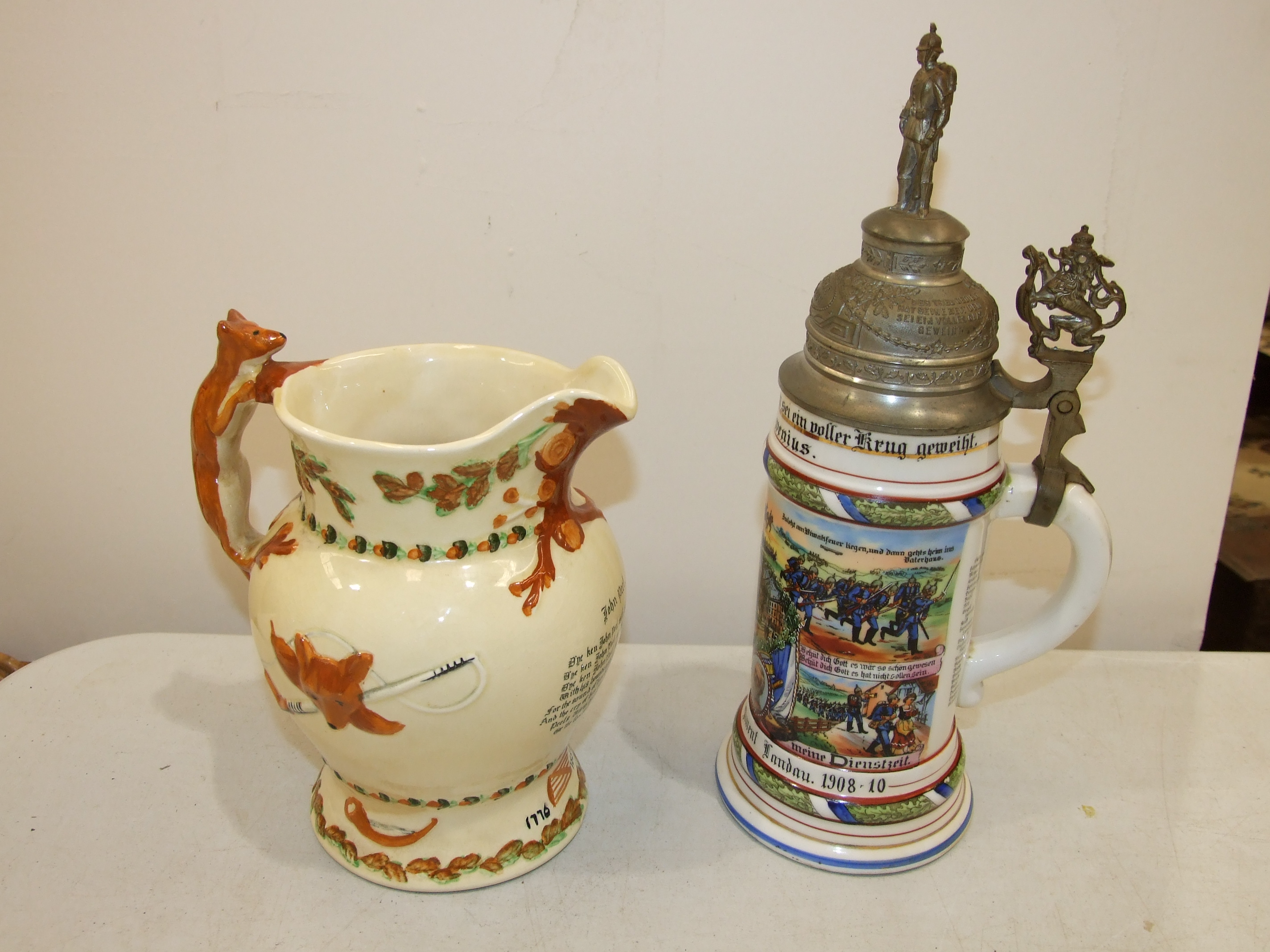 A Crown Devon Fielding 'John Peel' musical jug, 21cm high, (some staining) and a modern German - Image 2 of 4