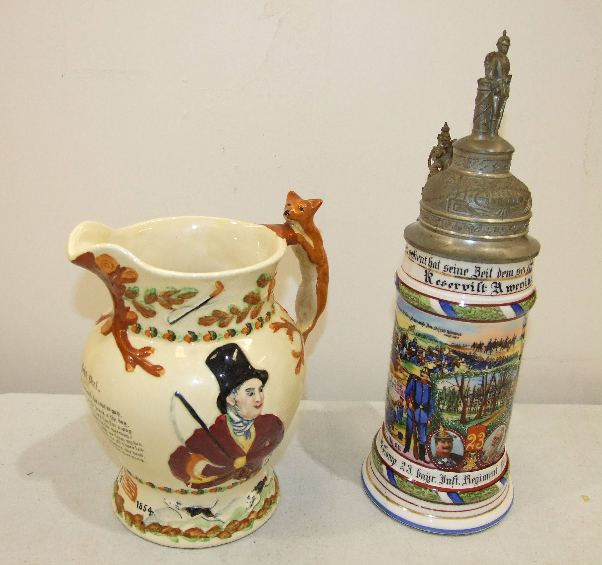 A Crown Devon Fielding 'John Peel' musical jug, 21cm high, (some staining) and a modern German - Image 3 of 4