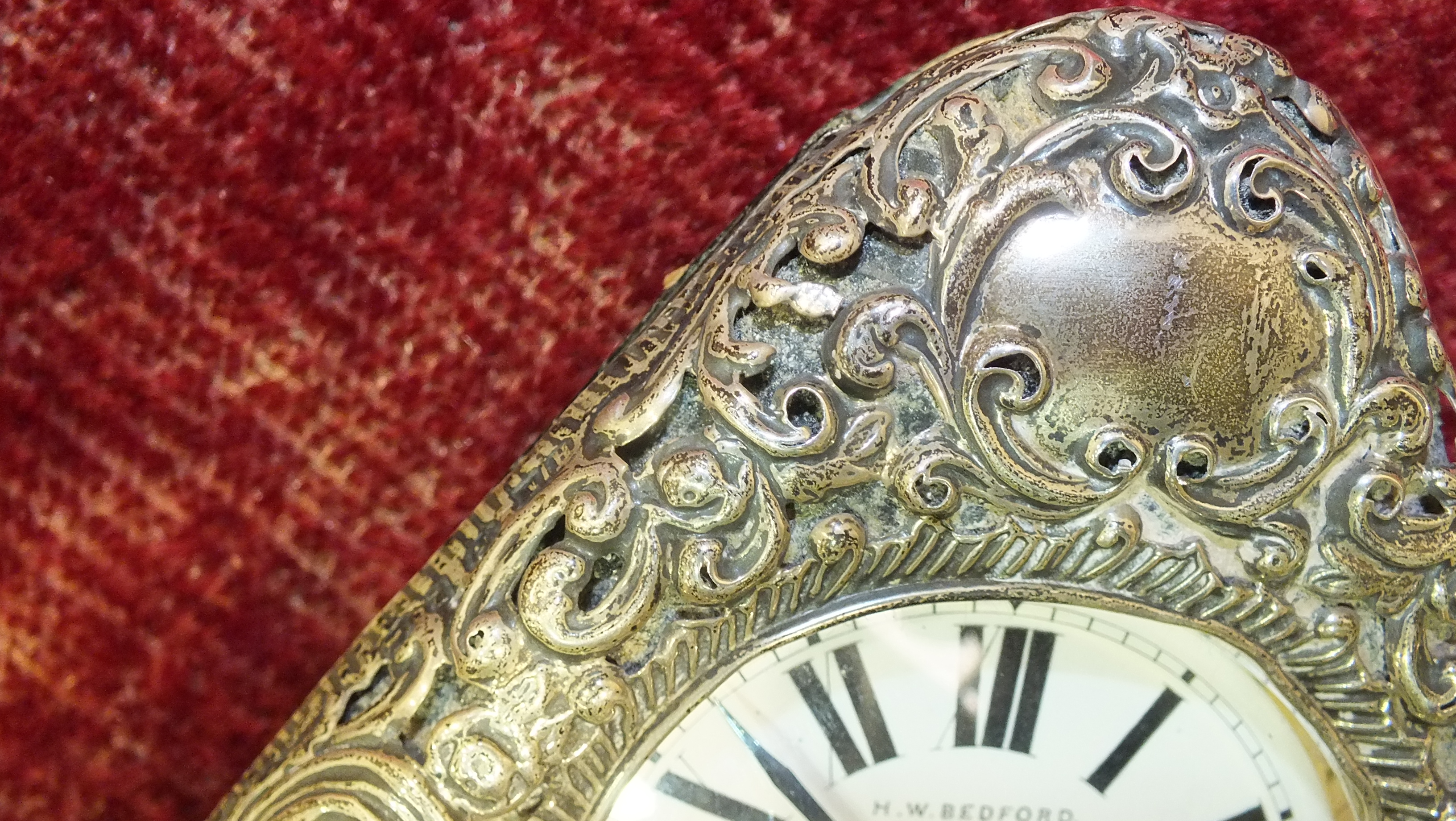 A silver embossed pocket watch holder of triangular form, Birmingham 1898, 11.5 x 11.5cm, (holes - Image 6 of 15