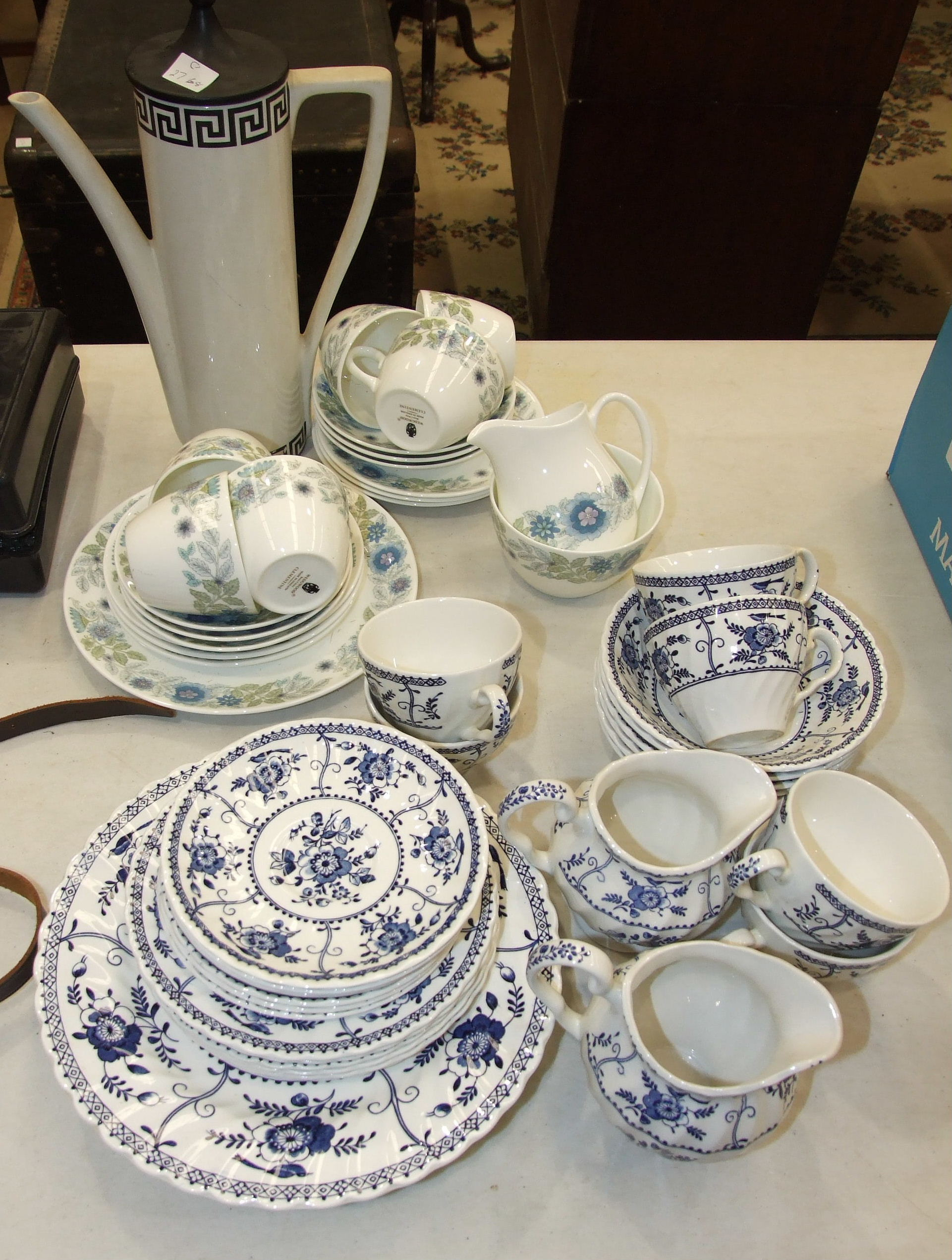 Nineteen pieces of Wedgwood 'Clementine' tea ware, thirty-two pieces of Johnson Bros 'Indies' tea