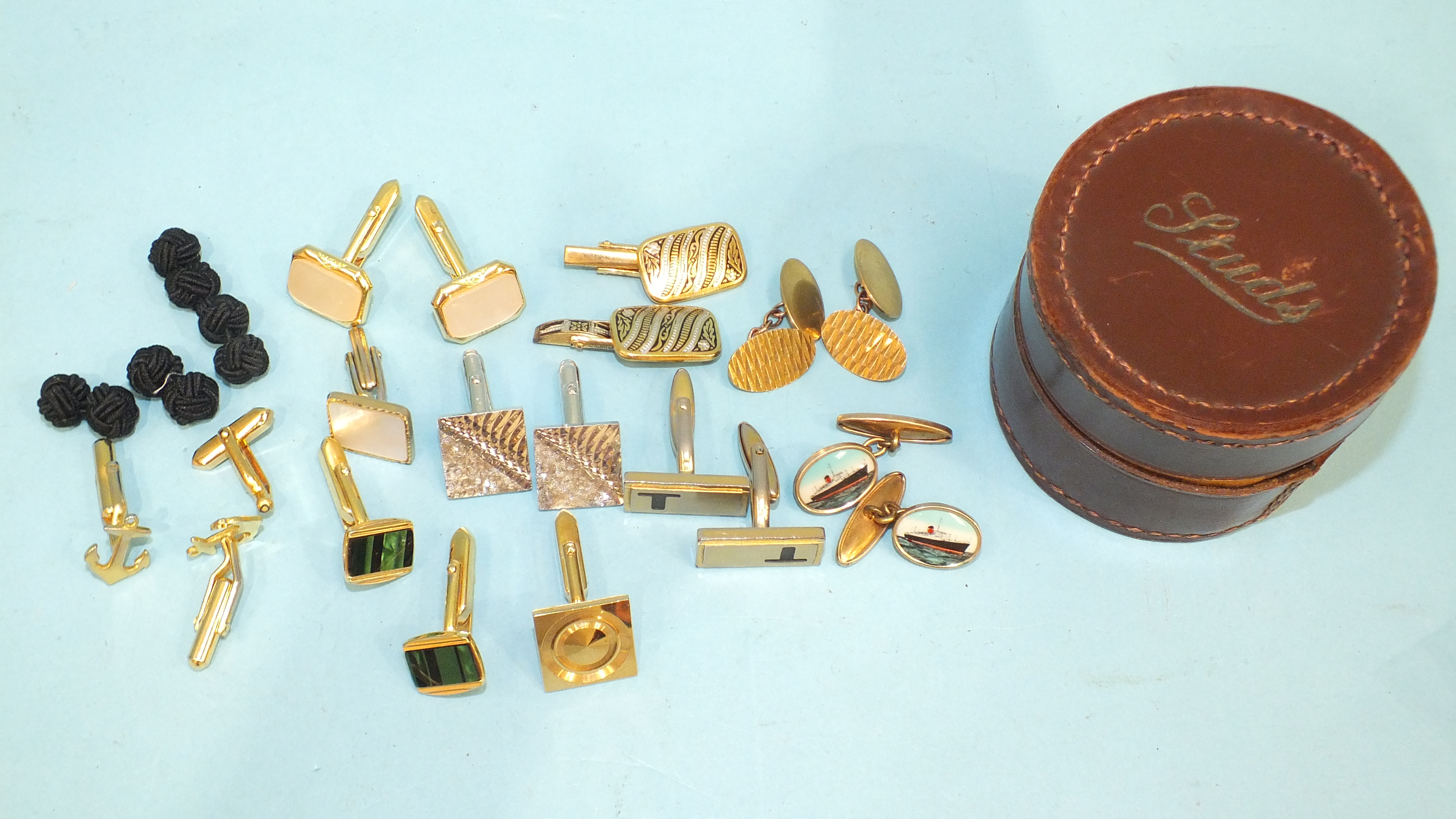 A pair of 9ct gold plain oval cufflinks, 5.3g and other metal cufflinks.