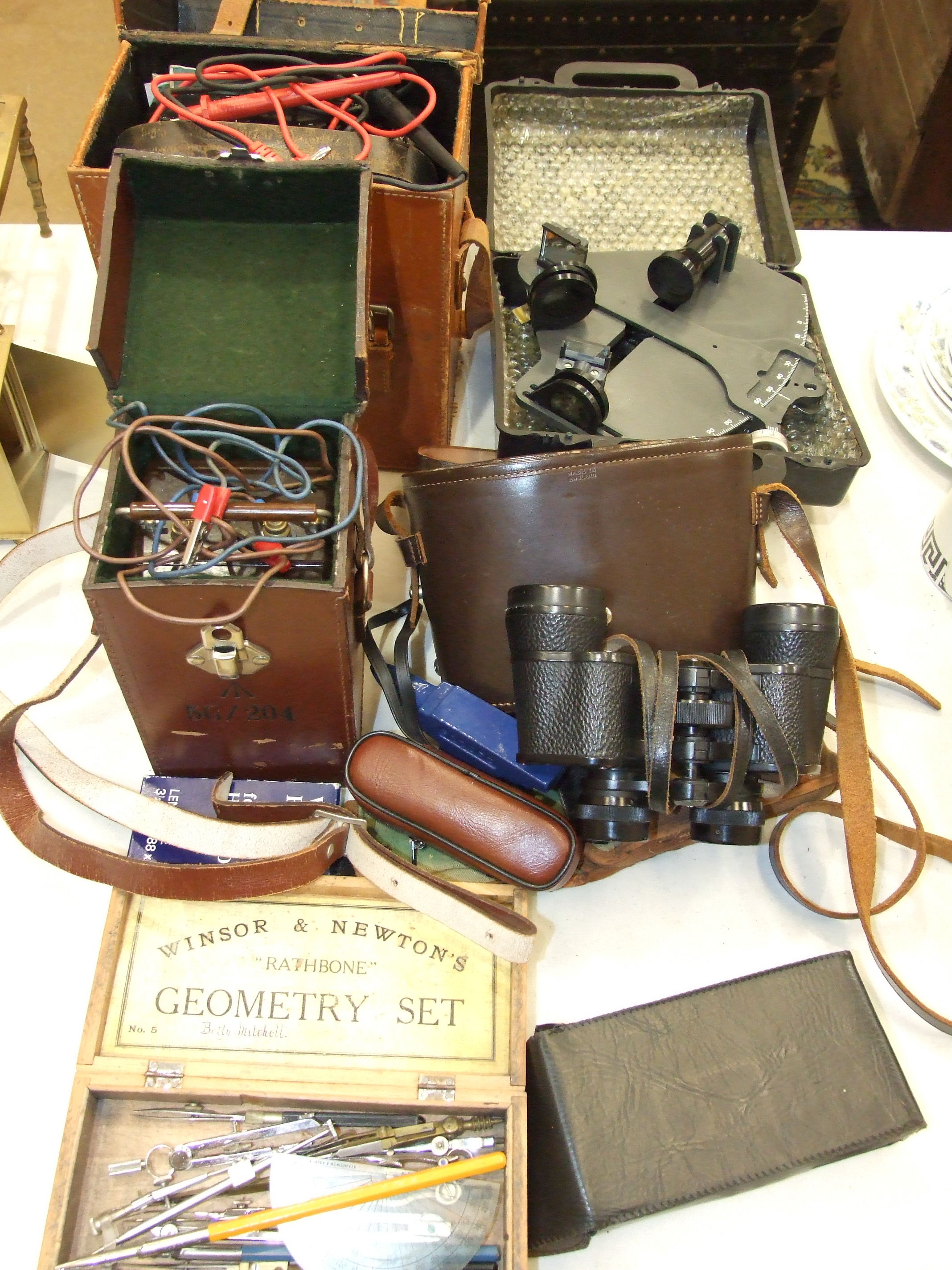 An Avo Model 8 Universal Avometer in leather case, a Record 'Minor' insulation tester, a pair of