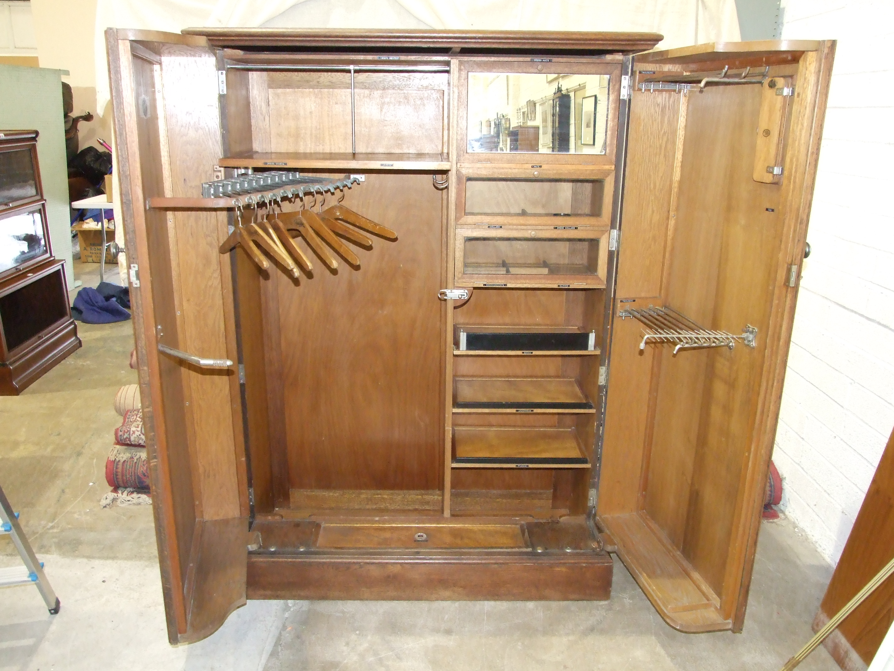 """An oak """"Compactum"""" wardrobe with fully-fitted interior, including glazed compartments, trouser and - Image 4 of 5"""