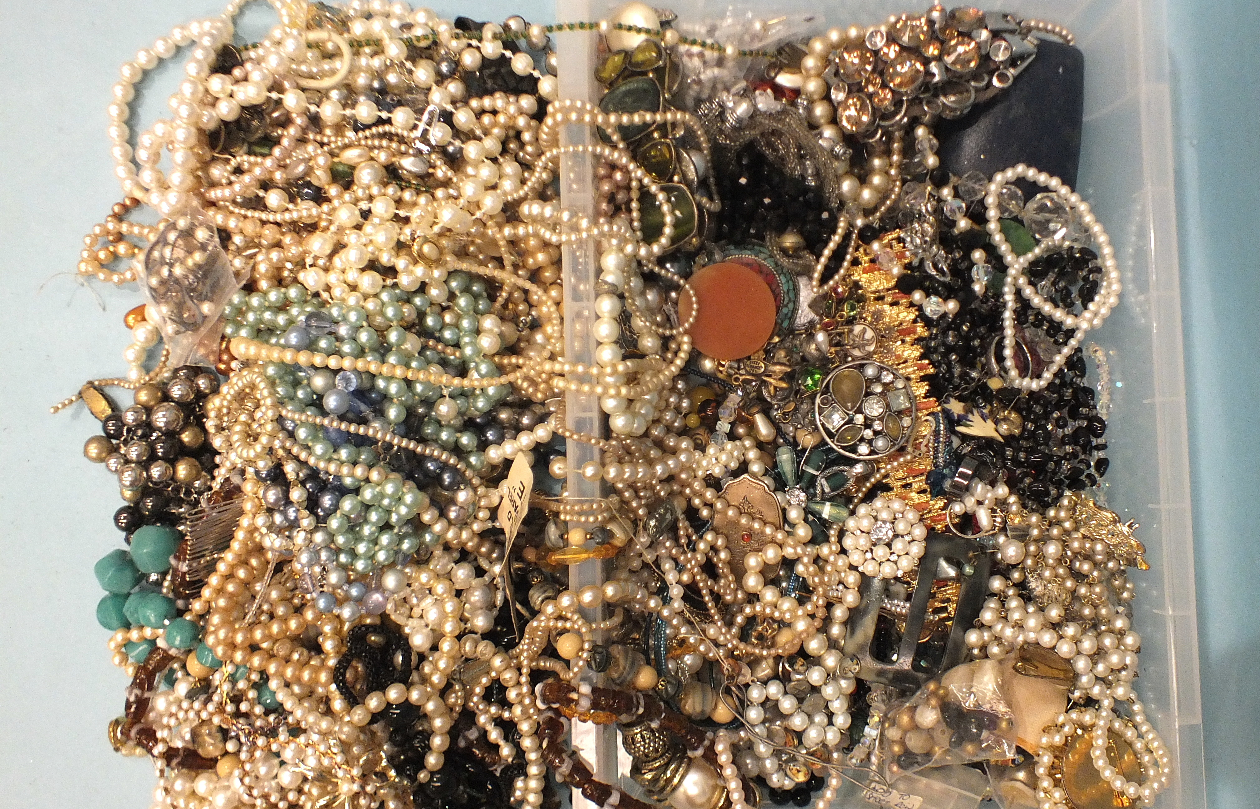 A large quantity of bead necklaces and other costume jewellery.