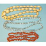 A Victorian string of graduated ivory beads, a string of graduated rock crystal beads and a coral