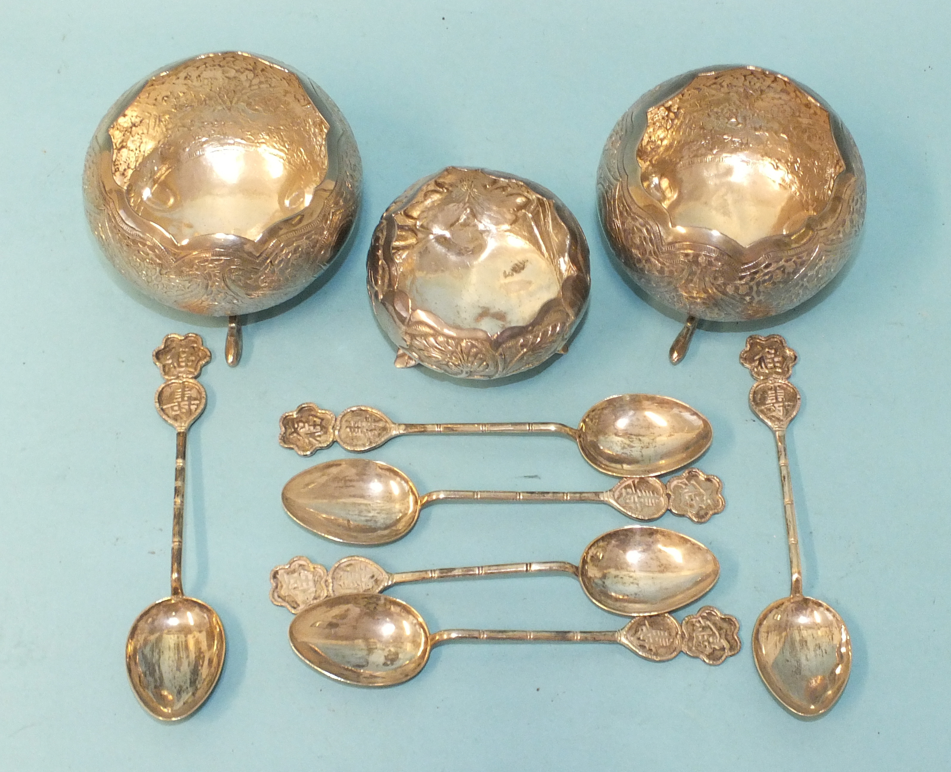 A set of six Oriental silver teaspoons with Chinese character terminals, marked '900 Silver', two