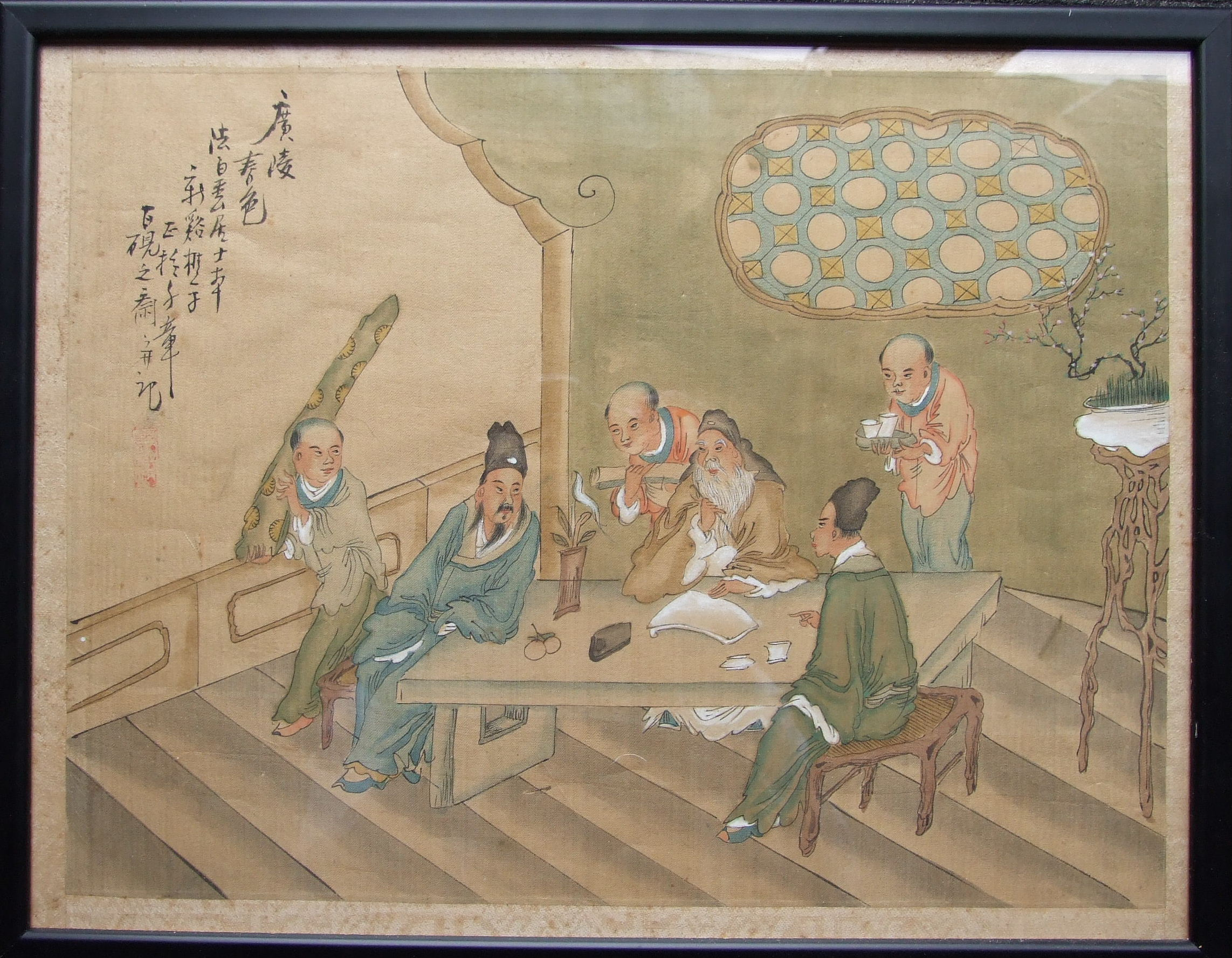 An Oriental silk painting, 'Figures seated around a table', 28 x 36cm, another of male and female