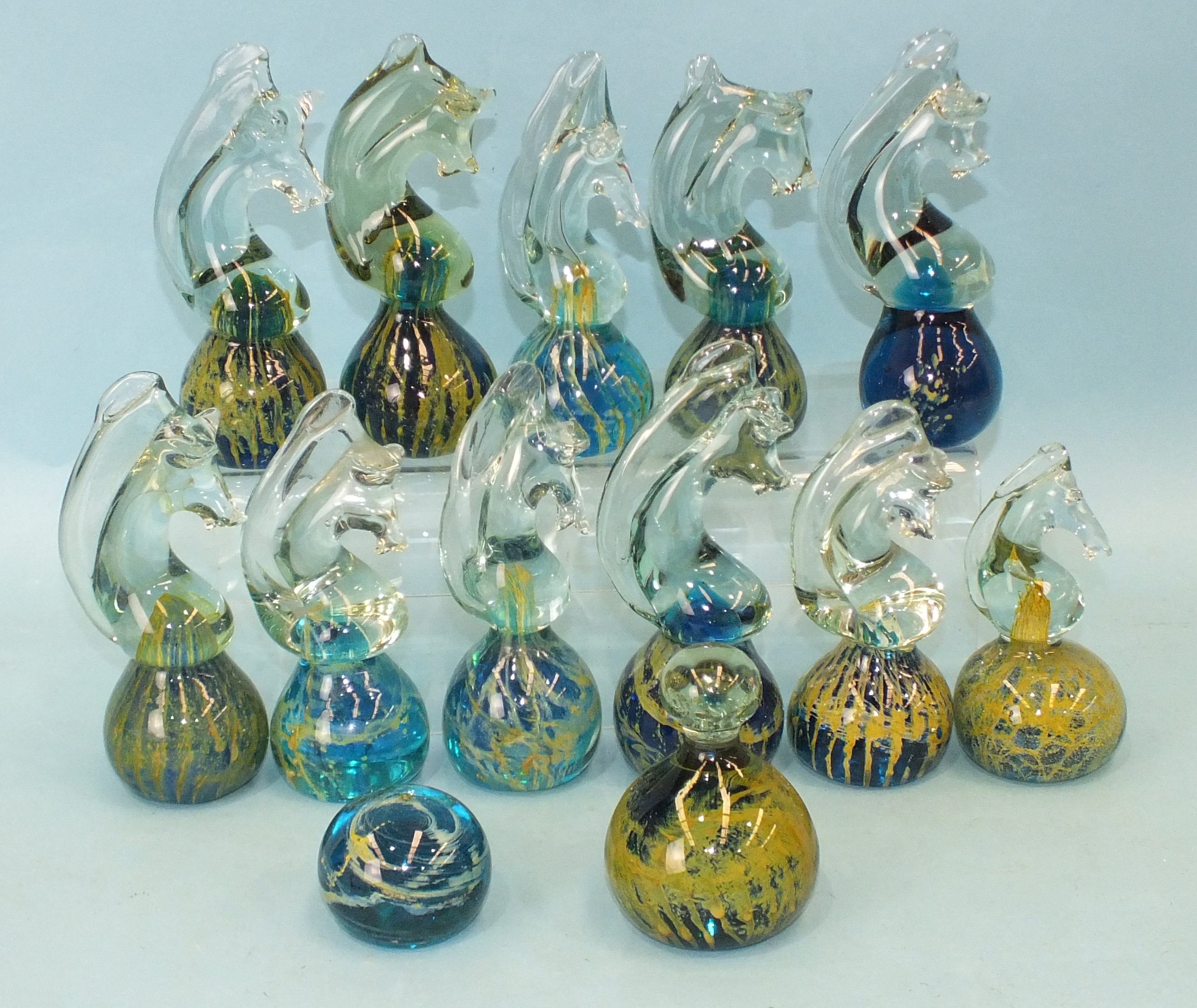 A collection of eleven Mdina glass seahorse paperweights and two others, (13).