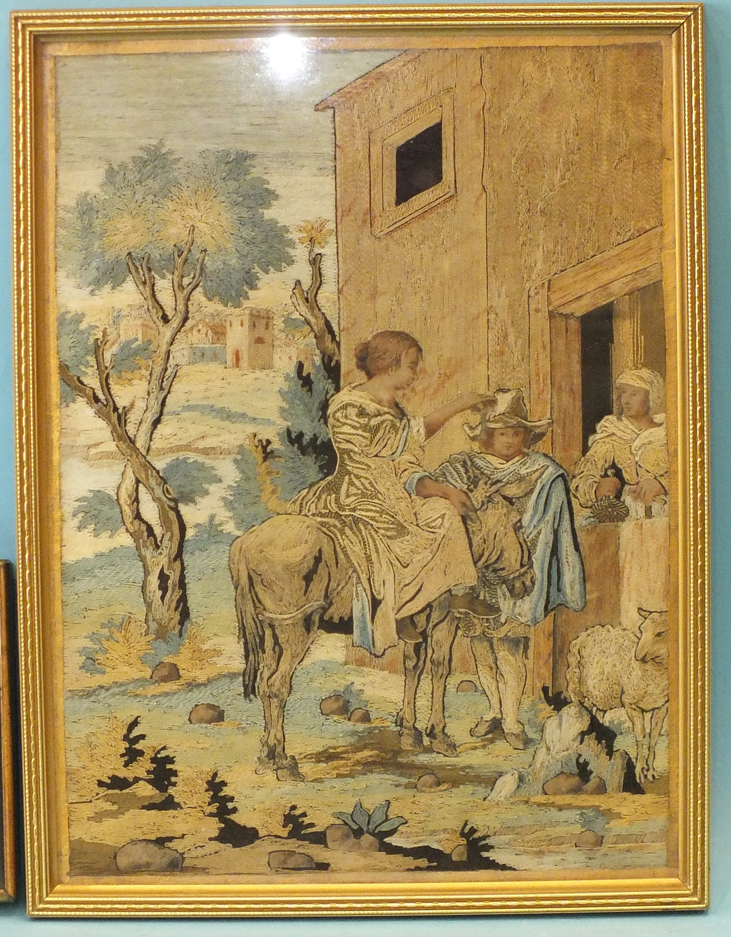 A 19th century needlework panel, with figures, a donkey, sheep and a village behind, 28 x 20cm and a - Image 2 of 3